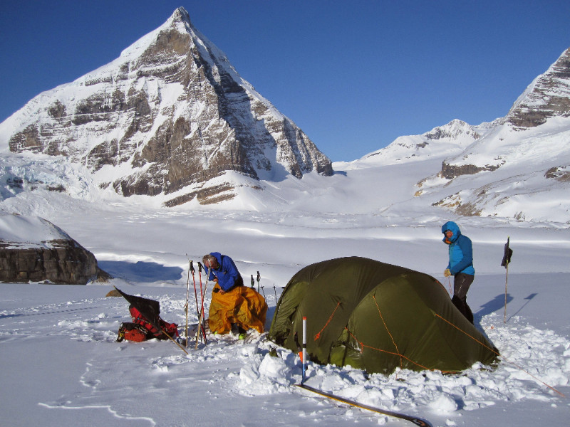 2 Skiers are setting up a Stunning snowy camp amongst the huge Rockies